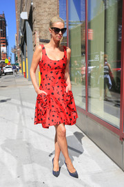 Nicky Hilton paraded her post-pregnancy figure in a red and black floral dress by Carolina Herrera while out in New York City.