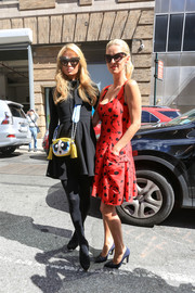 Paris Hilton added a fun touch with a Moschino Powerpuff Girls cross-body bag.