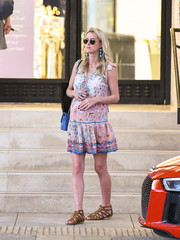 Nicky Hilton stayed comfy in flat gladiator sandals.