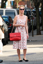 Nicky Hilton cut a sweet figure in a cherry-print sundress by HVN while out and about.