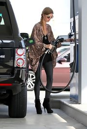Nicky Hilton was chic wile running errands, wearing an animal print sweater paired with black lace-up ankle boots.
