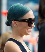 Nicole Richie's blue hair was elegantly styled into a sleek twisted bun for her appearance on 'Extra.'