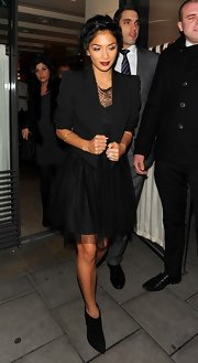 Nicole gave her romantic LBD a fall edge with a pair of supple suede ankle boots.