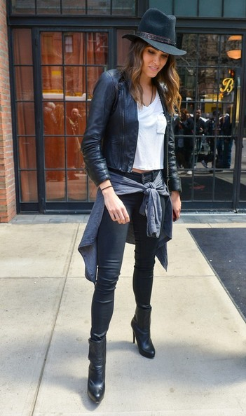 Nikki Reed sealed off her edgy look with a pair of black mid-calf boots.