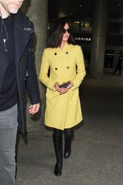 Nina Dobrev looked charming in a double-breasted coat by L.K.Bennett as she arrived on a flight at LAX.