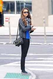 Nina Dobrev toted her things with this leather shoulder bag while out and about.