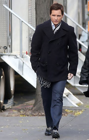 Actor Peter Facinelli was spotted on set wearing a classic navy blue pea coat.