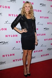 Stacy Keibler toughened her sexy LBD with a cropped black leather jacket with laced sleeves.