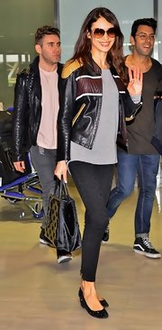 Olga Kurylenko chose a black striped leather jacket for her look while traveling to Japan.
