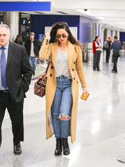 Underneath her coat, Olivia Munn was rugged in ripped jeans.