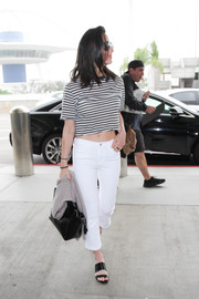 Olivia Munn flaunted some abs in a black-and-white striped crop-top while catching a flight out of LAX.