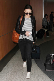 Olivia Wilde teamed a striped tee with a leather jacket for a comfy travel look.