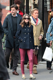 Olivia Palermo was on-trend for fall in red leggings paired with taupe smoking slippers.