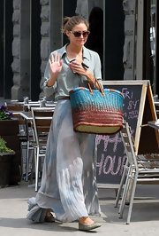 Olivia Palermo ran errands in Tribeca carrying a blue and brown ombre straw tote.