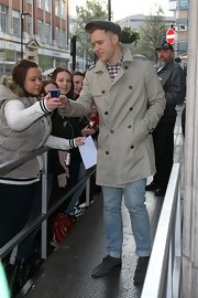 Olly Murs entertained his fans outside Radio 1 wearing a gray trenchcoat.