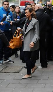 Jessica Ennis' silver swing jacket was an elegant addition to her black blouse and skinnies combo.