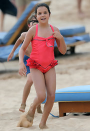 Bailee Madison was spotted having fun at the beach set of 'Just Go With It' wearing an orange monokini.