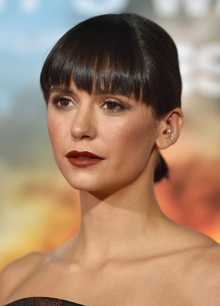Nina Dobrev wore her hair in a ponytail with eye-grazing bangs at the world premiere of 'Only the Brave.'