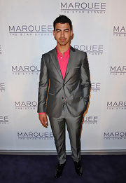 Joe Jonas was dapper on the red carpet of the Marquee Night Club opening in Australia in this silver suit.