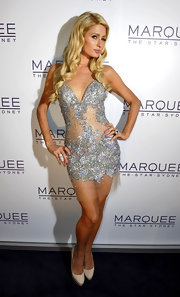 Paris Hilton showed off her fierce posing in this beaded tulle cocktail dress at the opening of Marguee Night Club in Australia.