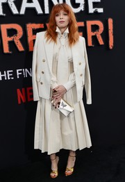 Natasha Lyonne pulled her look together with a butterfly-embellished envelope clutch.