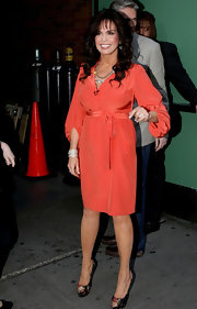Marie Osmond served up her 'Good Morning America' interview in this salmon wrap dress.