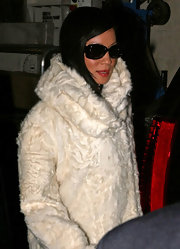 Lucy Liu looked glamorous in a cream furry coat, which she wore with black movie star shades.