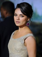 Mila Kunis dressed up her red carpet look with African ruby and diamond dangle earrings at the world premiere of 'Oz the Great and Powerful.'