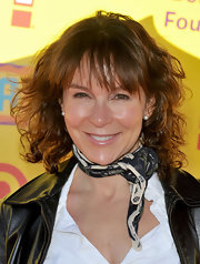 Jennifer Grey added wispy bangs to her trademark short curls when she attended the P.S. Arts Express Yourself.