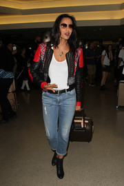 Padma Lakshmi was spotted at LAX towing a stylish Louis Vuitton rollerboard.