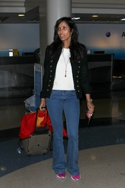 Padma Lakshmi's black military jacket provided a smarter finish to her casual airport look.
