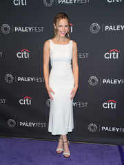 Halston Sage styled her dress with a pair of monochrome sandals.