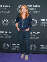 Lea Thompson paired her blouse with classic blue jeans.