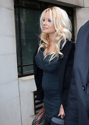The iconic blonde bombshell showed off her signature tresses with a tousled wave hairstyle and piecey bangs.