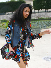 Chanel wore a denim vest over her floral dress for Paris Fashion Week.
