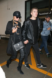 Paris Hilton sealed off her all-black look with a studded shoulder bag, also by Philipp Plein.