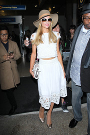 Paris Hilton matched a two-piece set with her top and white skirt that had eyelet cut-out detailing.