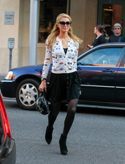 Paris Hilton finished off her outfit with black Alice + Olivia tights and a pair of ankle boots.