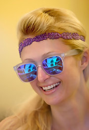 Paris topped off her fun vacation look with blue mirrored wayfarers featuring a clear frame.