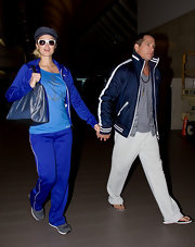 Paris Hilton matched her all blue look with a metallic blue tote.