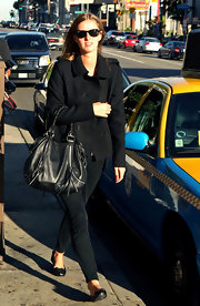 Nicky Hilton matched her black Wayfarer shades to an all black outfit. The only pop of color was her short red nails.