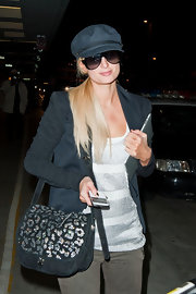 Paris Hilton kept on trend with a gray metallic leopard print purse.