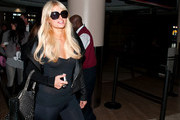 Paris Hilton wears see-through black tights at Los Angeles International Airport (LAX), leaving very little to the imagination.
