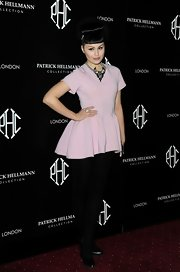 Viktoria Modesta mixed playful and fun with hardcore and edgy with this pink mini dress and black tights.