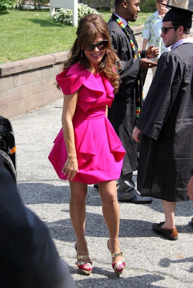 Paula Abdul attended her nephew's college graduation wearing metallic gold and fuchsia strappy platform sandals.