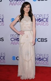 Ashley Rickards was quietly glitzy on the red carpet in this beaded cream gown.