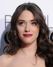 Kat Dennings made her pout pop with this bold berry hue.