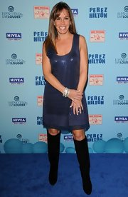 Black suede knee-high boots add a sassy edge to Melissa's blue sequined dress at a party in LA.