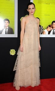 Emma looked quietly elegant in this tiered nude gown with delicate subtle beading.