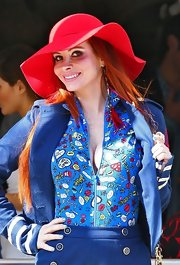 Phoebe Price wore a wide-brimmed red felt hat with her nautical ensemble.